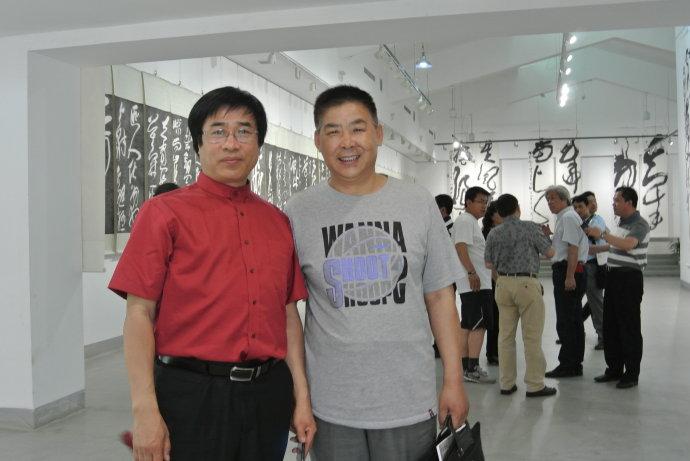 王登武与中国人民革命军事博物馆美术书法创作中心副主任兼秘书长张继